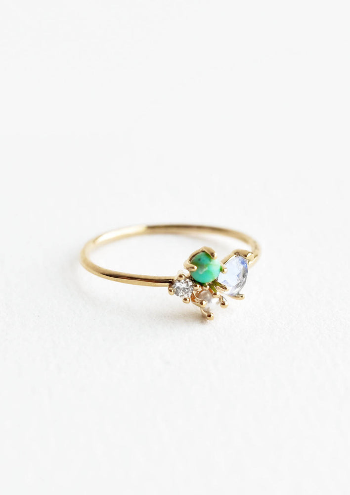 Turquoise Multi / Size 6: Gold ring featuring slim band with two gemstones and two crystals in blue, green and white hues, prong set in a cluster.