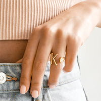 2: Model shot with hand wearing letter K ring.