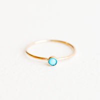 Turquoise / Size 5: Yellow gold ring with slim band and small blue turquoise stone.