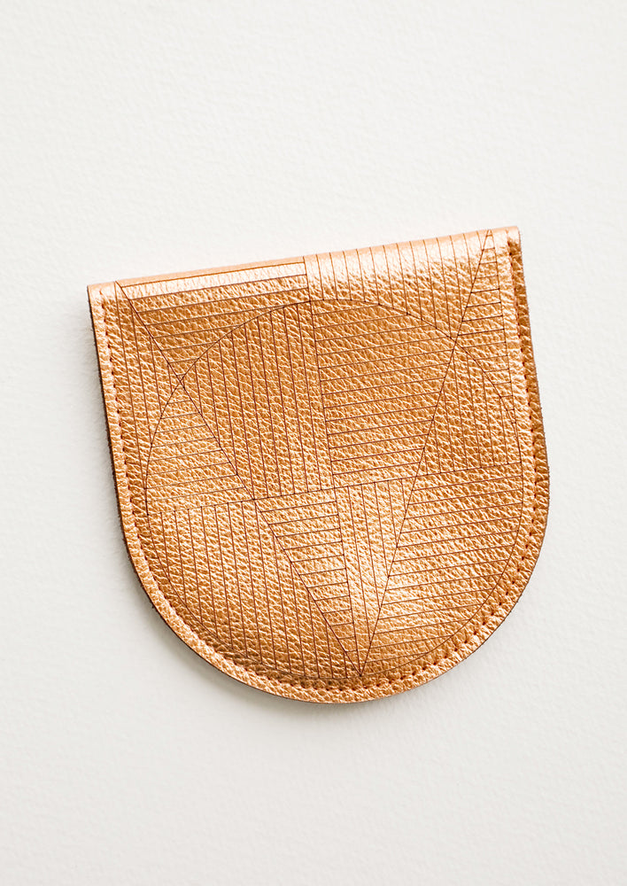 Copper: A metallic copper leather half-oval wallet with a subtle geometric pattern.