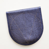 Metallic Navy: A metallic blue leather half-oval wallet with a subtle geometric pattern.