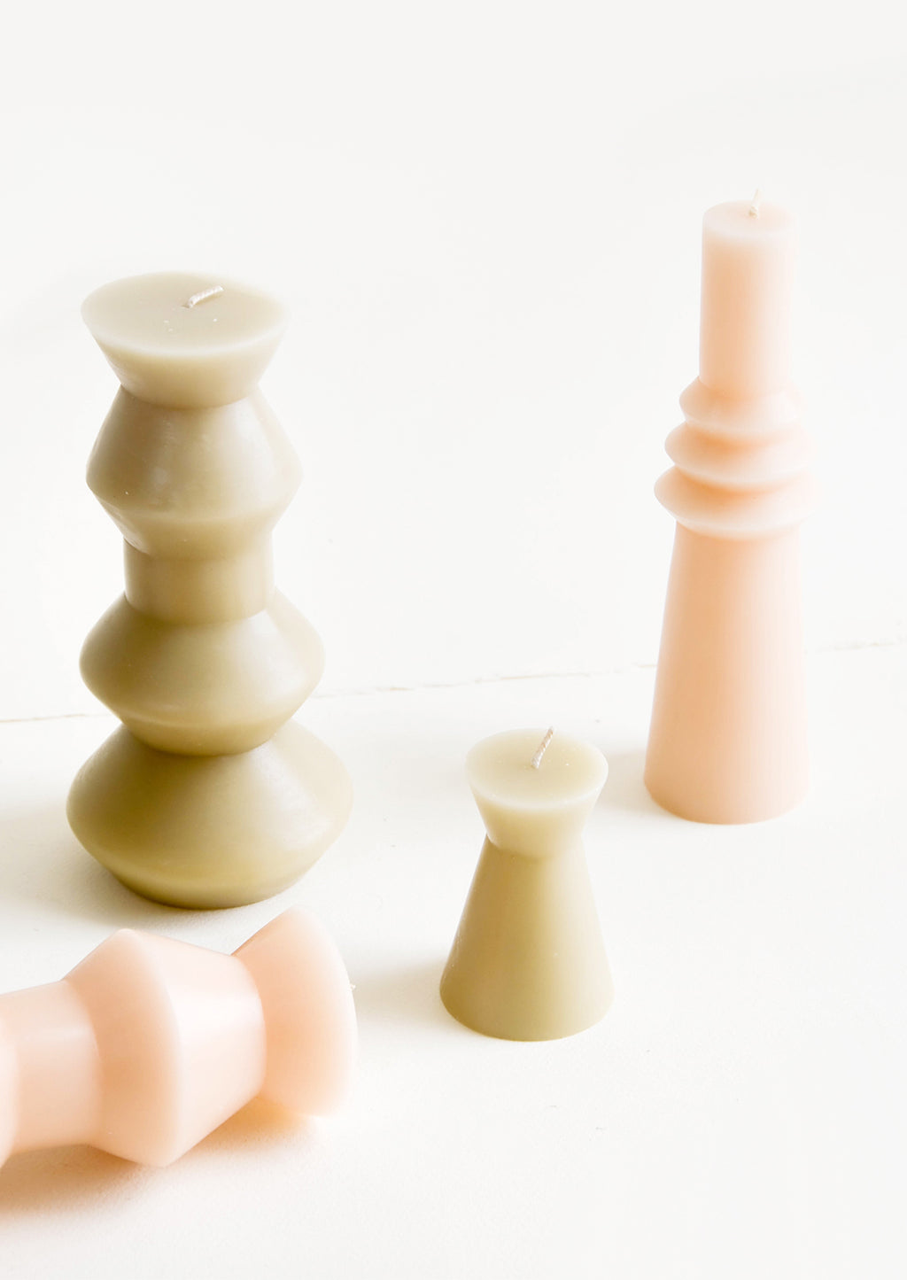 1: Shapely pillar candles in geometric forms, shown in a mix of shapes and sizes