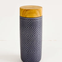 Stone Blue: Geometric textured ceramic tall travel tumbler in stone blue with bamboo lid