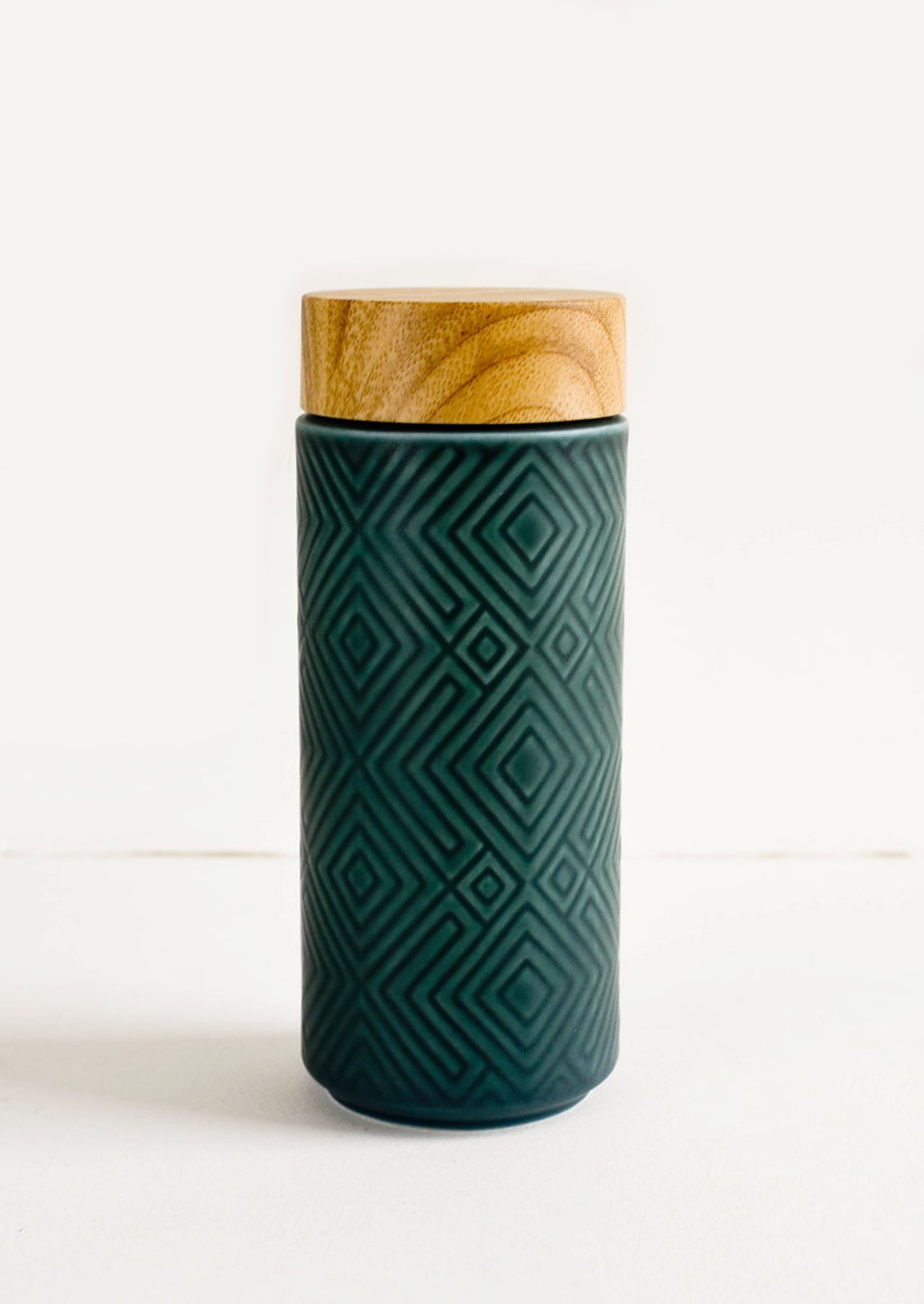 Peacock Green: Geometric textured ceramic tall travel tumbler in peacock green with bamboo lid
