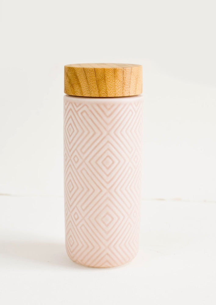 Rose Pink: Geometric textured ceramic tall travel tumbler in light pink with bamboo lid
