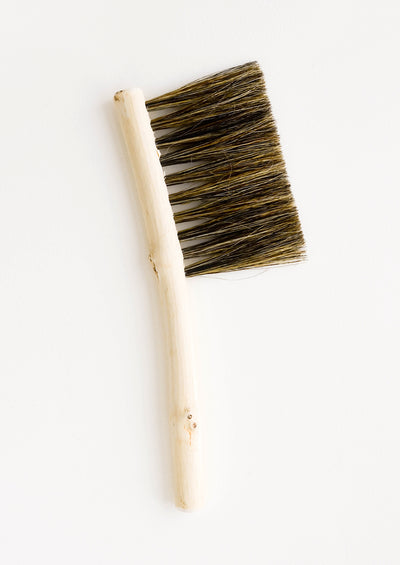 Hand carved bristle brush with thin wooden handle