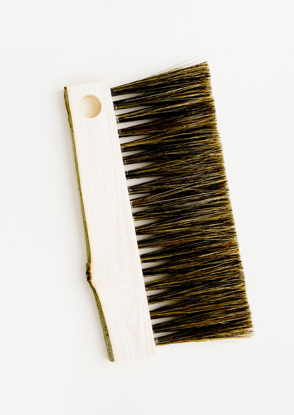 1: Drawing board bristle brush with bark-edged wooden handle and circular cutout for hanging