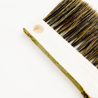 2: Drawing board bristle brush with bark-edged wooden handle and circular cutout for hanging