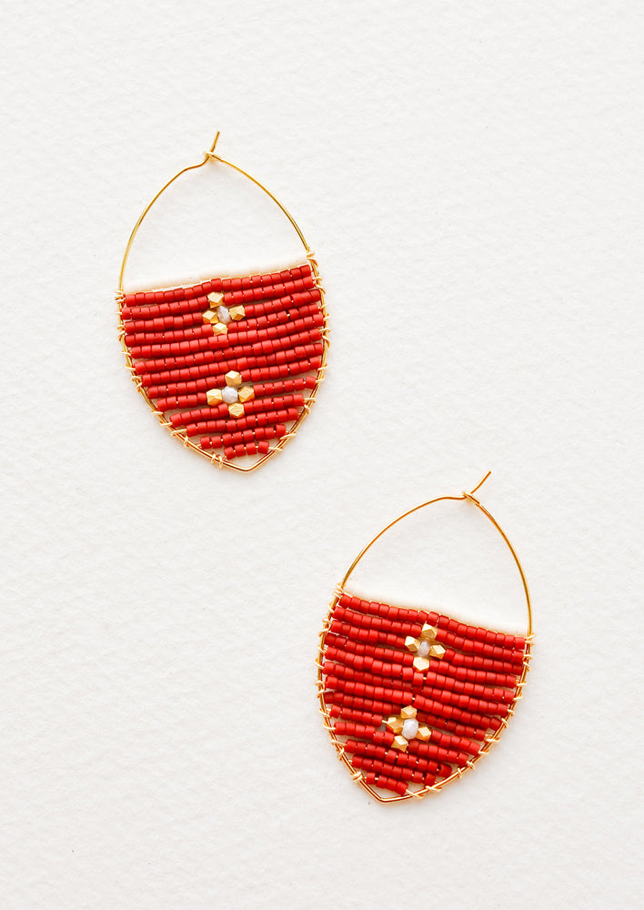 Crimson: Delicate gold drop earrings with a field of red glass beads featuring two gold equal-armed crosses.
