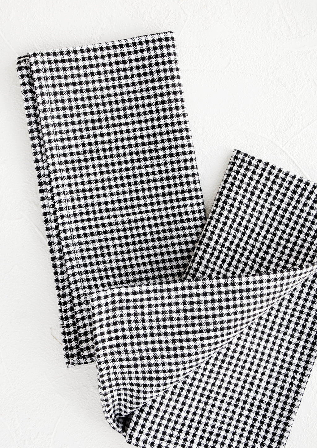 3: Pair of fabric dinner napkins in black and white gingham pattern