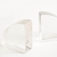 Large / Clear [$48.00]: Solid clear glass bookends shaped in a quarter-quadrant of a circle