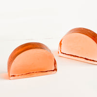 Small / Peach [$38.00]: Semi-circle shaped bookends with flat bottom and arched top, made in peach-hued solid glass