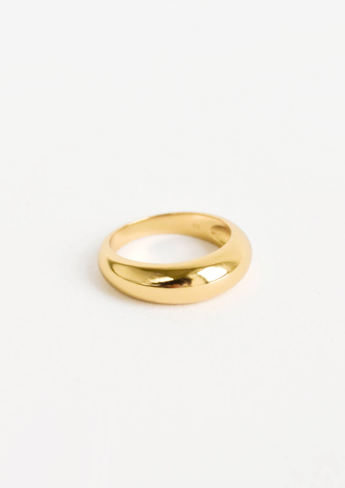 Golden ring with bulbous, dome-like front