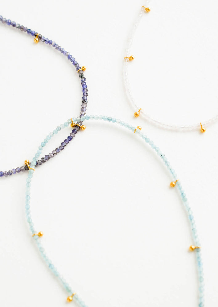 1: Three necklaces of gemstones and gold beads.