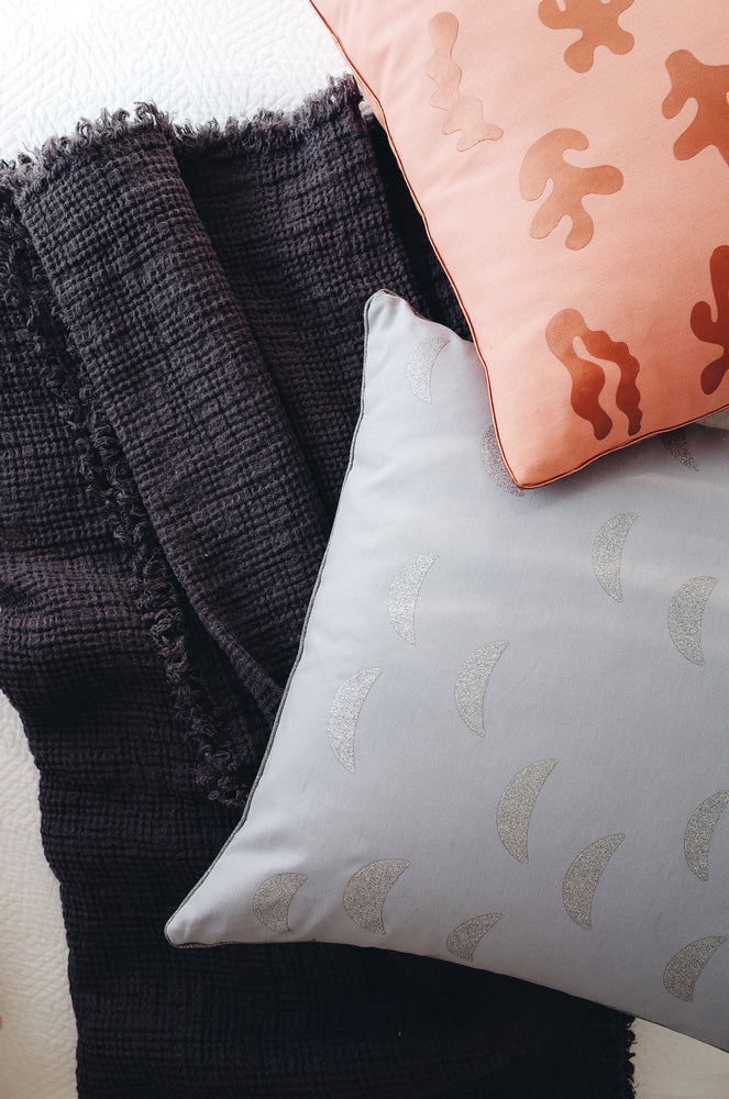 2: Stylized Image of Two Printed Pillows on Bed - LEIF