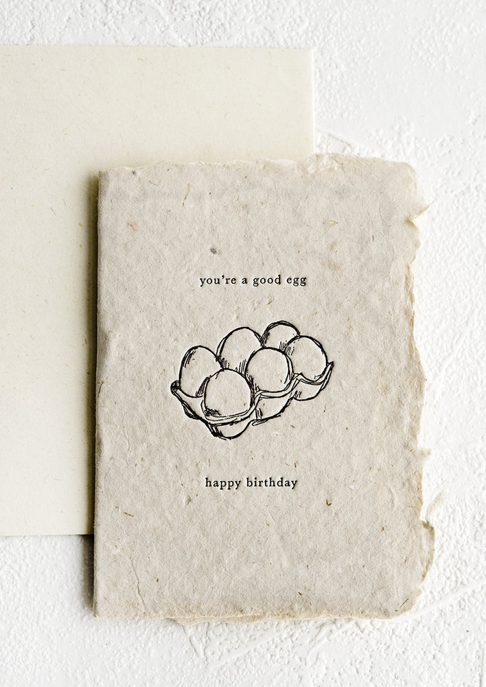 1: A birthday card made from handmade paper with image of an egg carton.