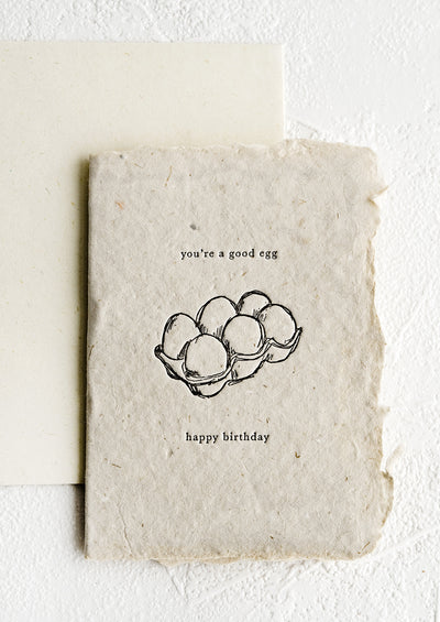 A birthday card made from handmade paper with image of an egg carton.