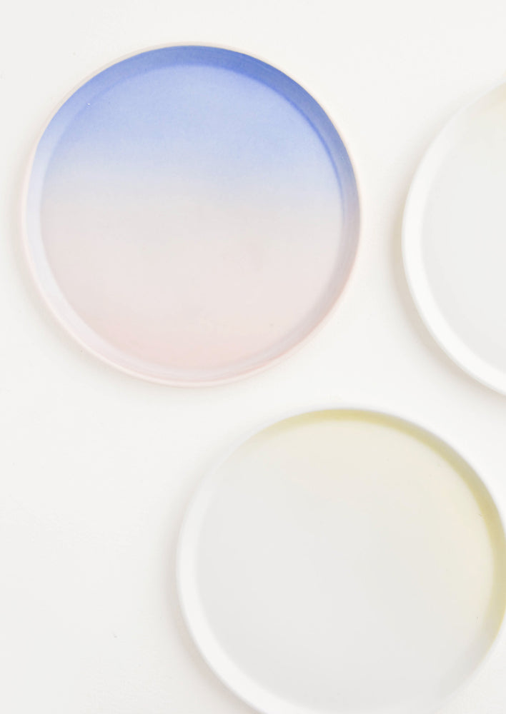 4: Three colorful ombre porcelain plates.