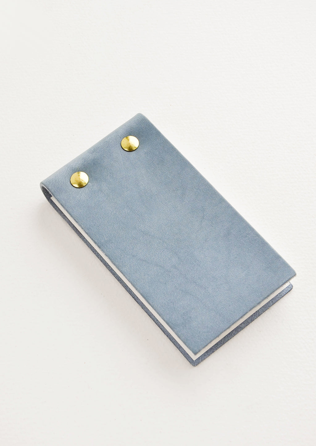 Dusty Blue: Small blue leather notepad with brass grommets.