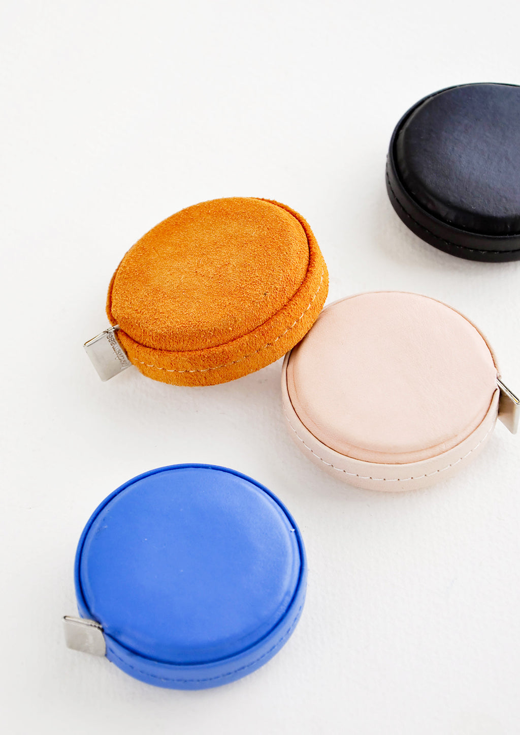Klein Blue: Product shot featuring multiple styles of leather covered tape measures.