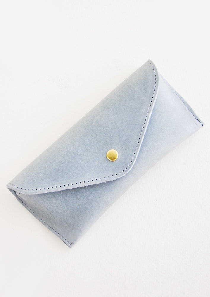 Dusty Blue: Dusty blue leather case for sunglasses that folds close with a snap.
