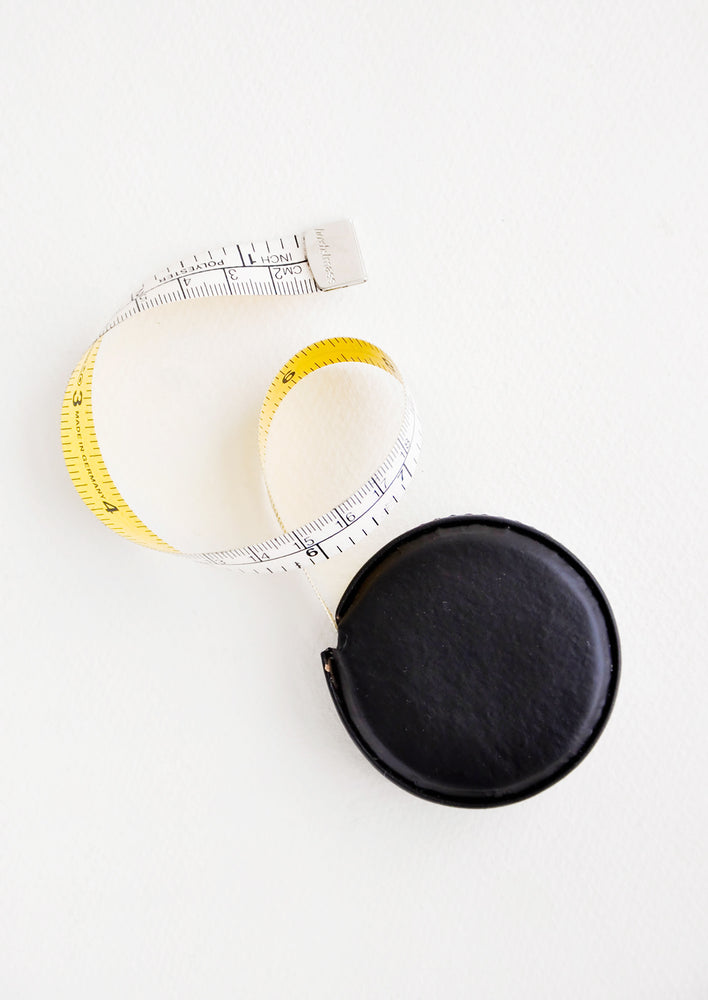 Black: Tape measure covered in black leather.