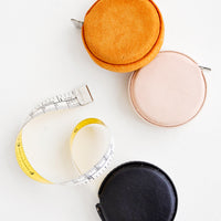 Mustard Suede: Product shot featuring multiple styles of leather covered tape measures.