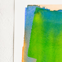 2: Art print of a watercolor abstract form in green, yellow, blue and orange.