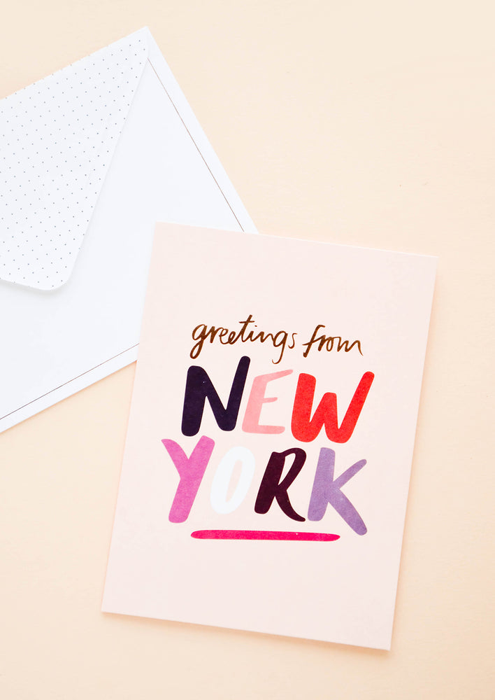 "1: Greeting card with text reading ""Greetings from New York"" in playful, multicolor lettering"