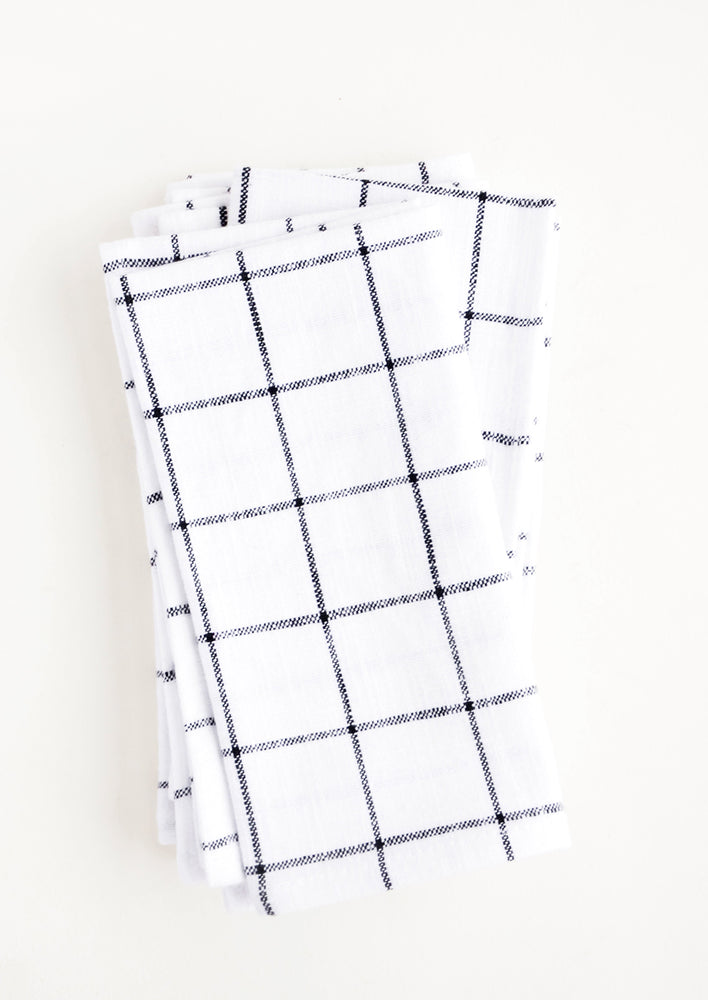 1: Pair of cloth cotton napkins in white with charcoal grid print