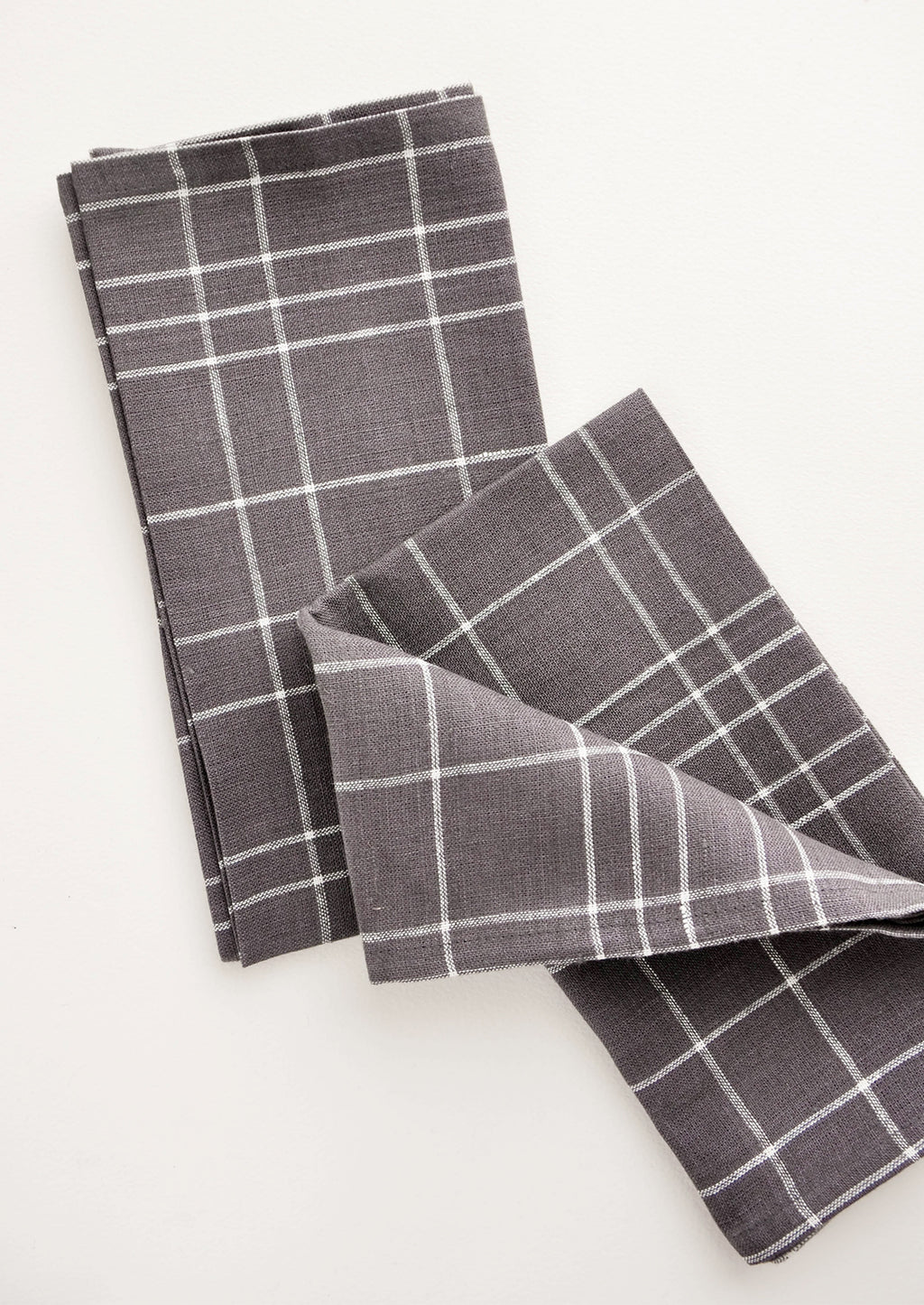 Charcoal Grid: Pair of fabric dinner napkins in grey and white grid pattern