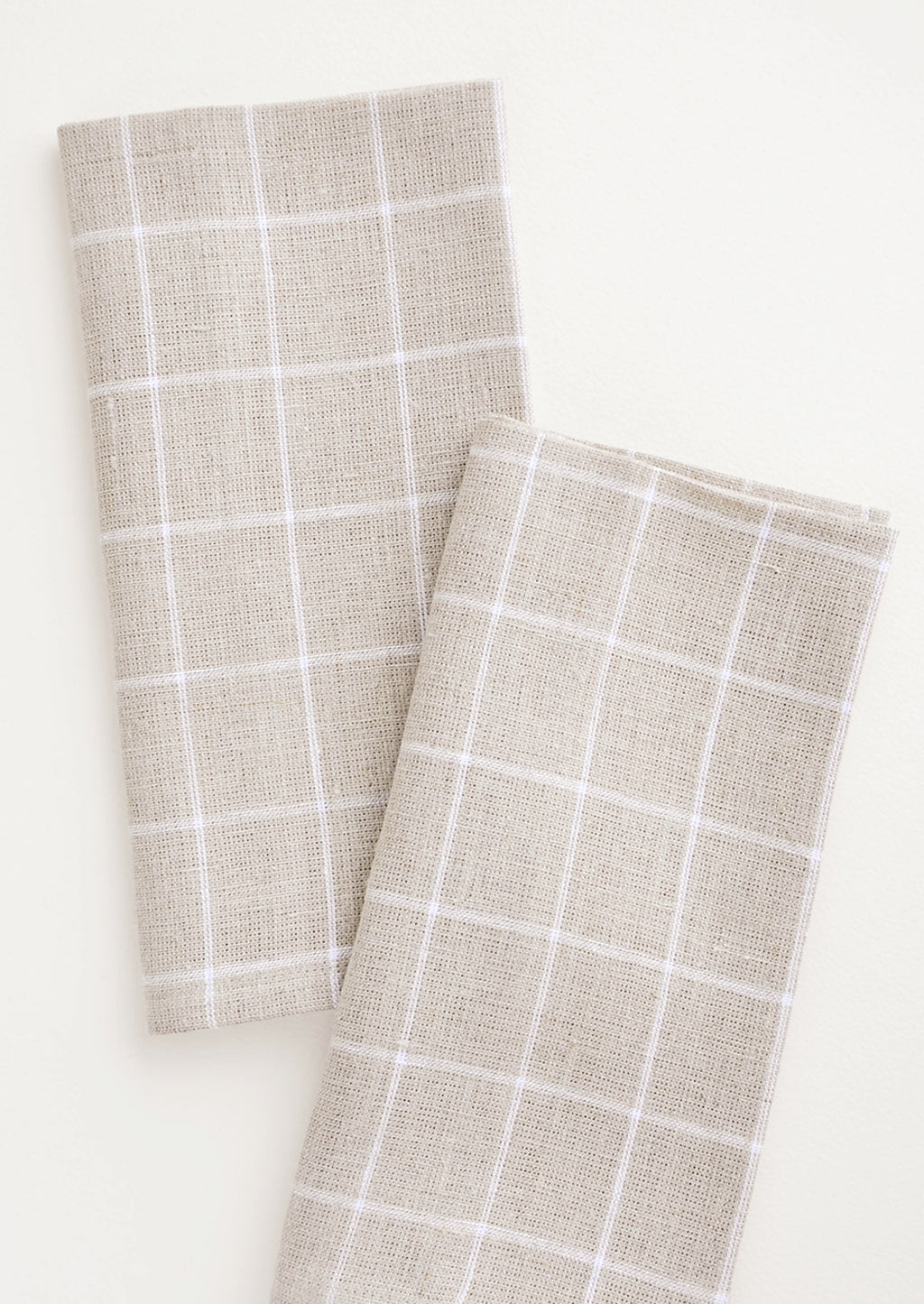 Flax Grid: Pair of fabric dinner napkins in beige and white grid pattern