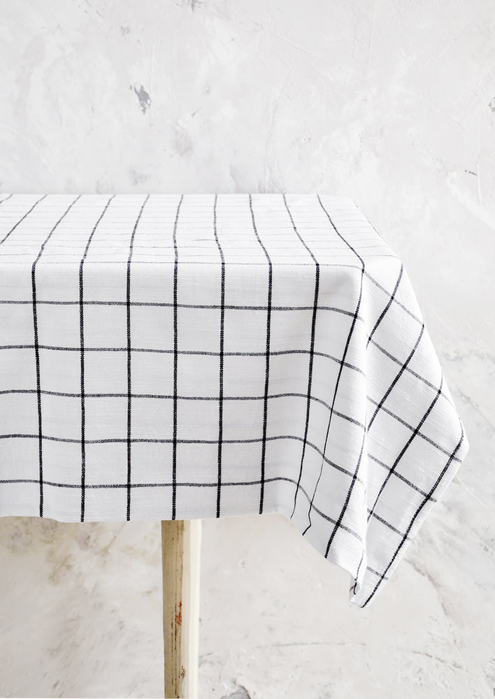 1: Black and white grid patterned tablecloth displayed over table