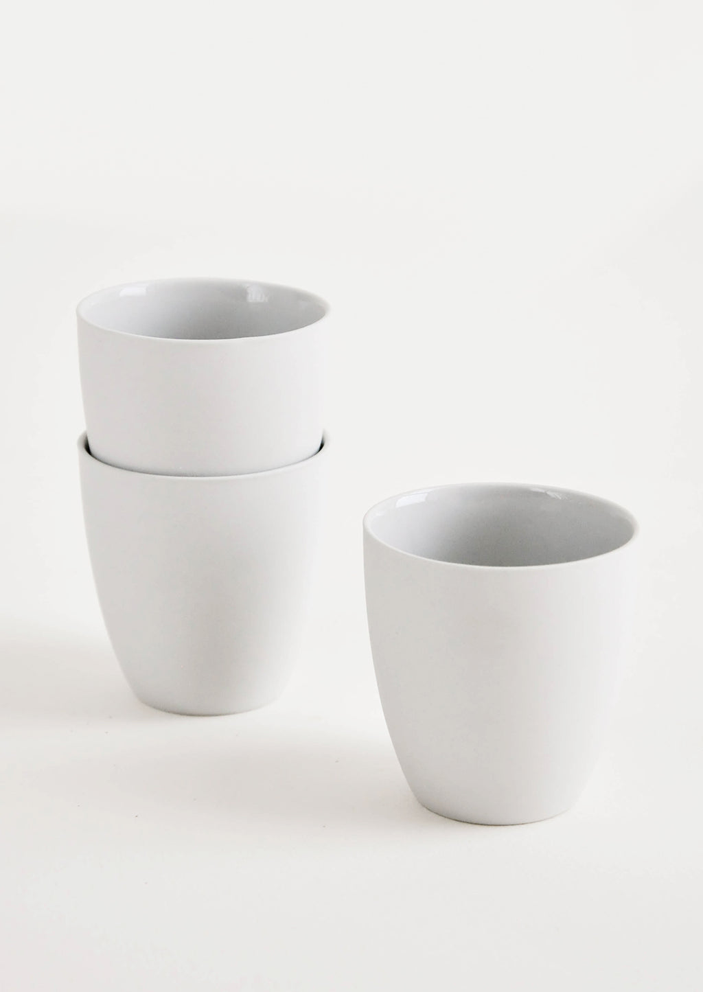 Grey: Small, light grey porcelain cup with matte exterior and glossy interior glaze - LEIF