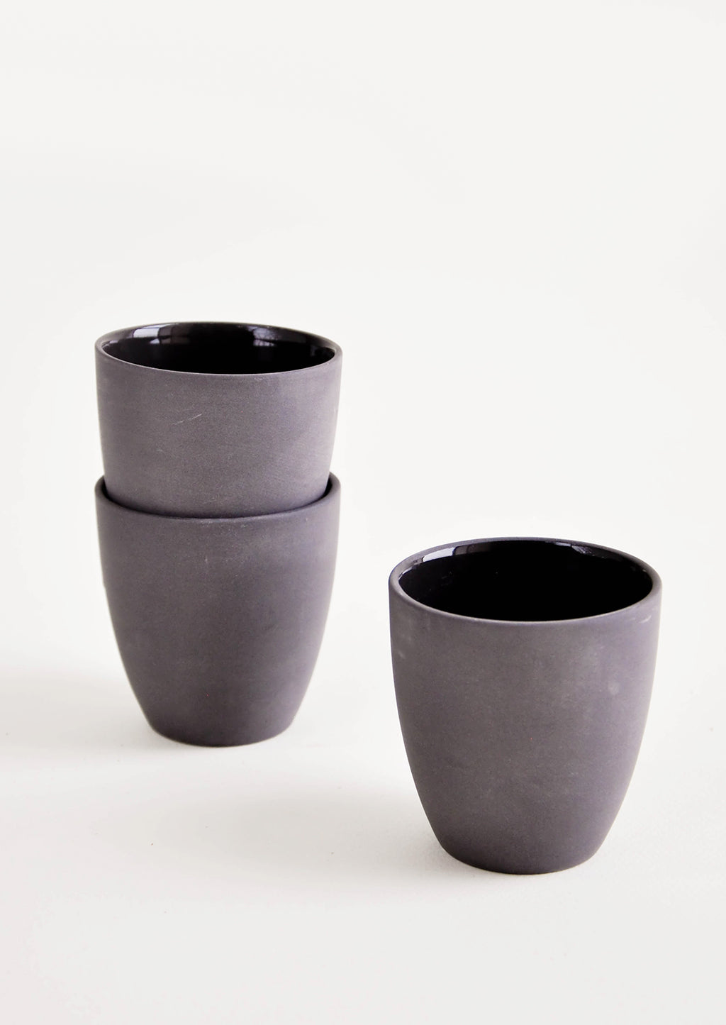 Black: Small black porcelain cup with matte exterior and glossy interior glaze - LEIF