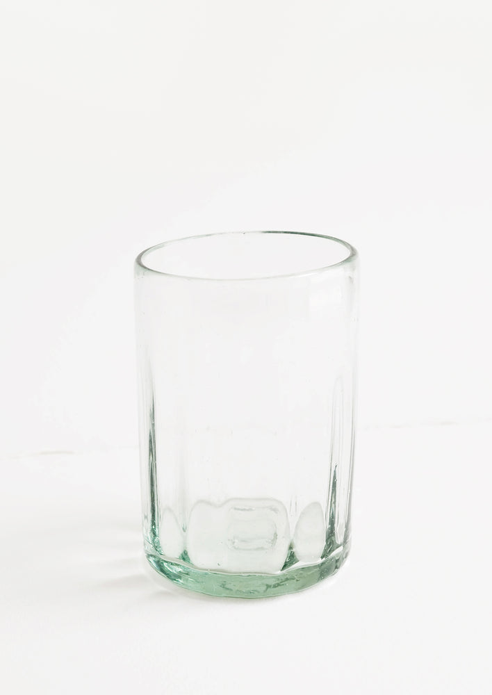 A horizontally ribbed tumblers in thick green hued glass.