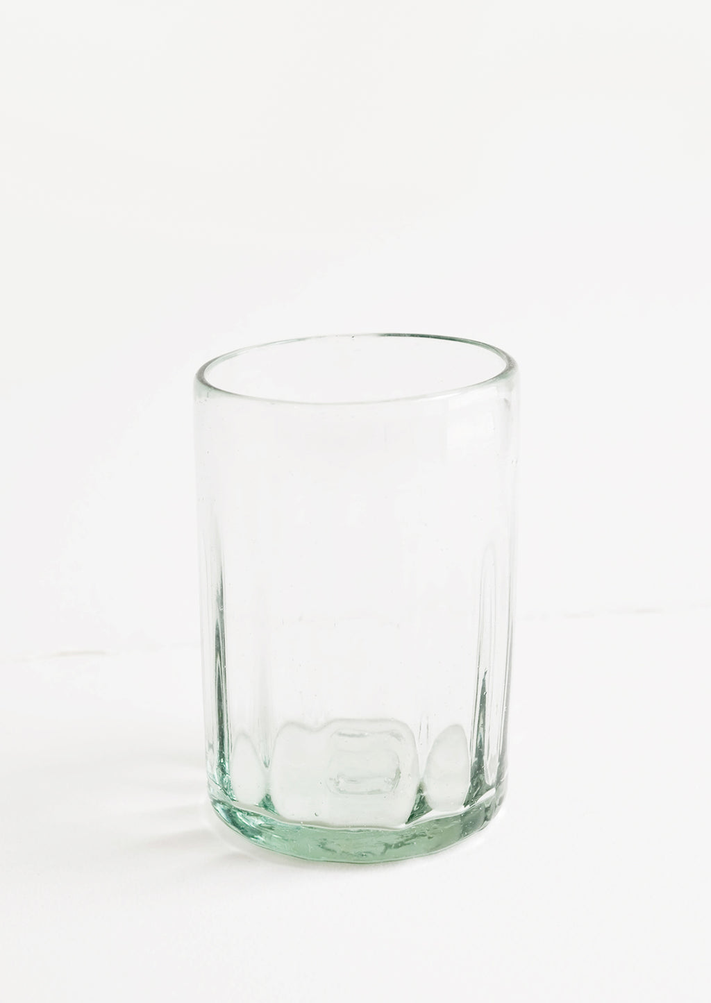 Wide [$16.00]: A horizontally ribbed tumblers in thick green hued glass.