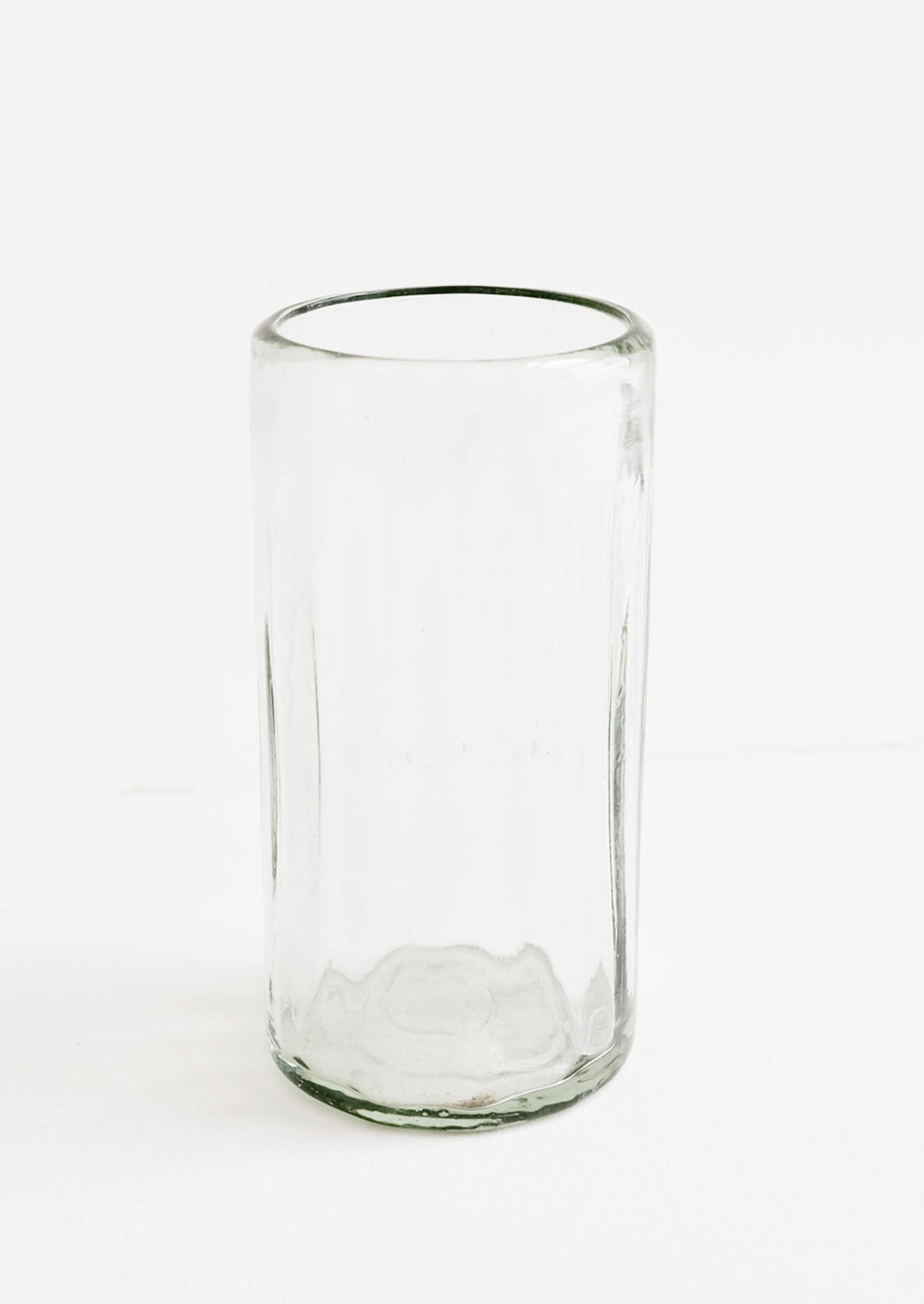 Tall [$14.00]: A horizontally ribbed tumblers in thick green hued glass.