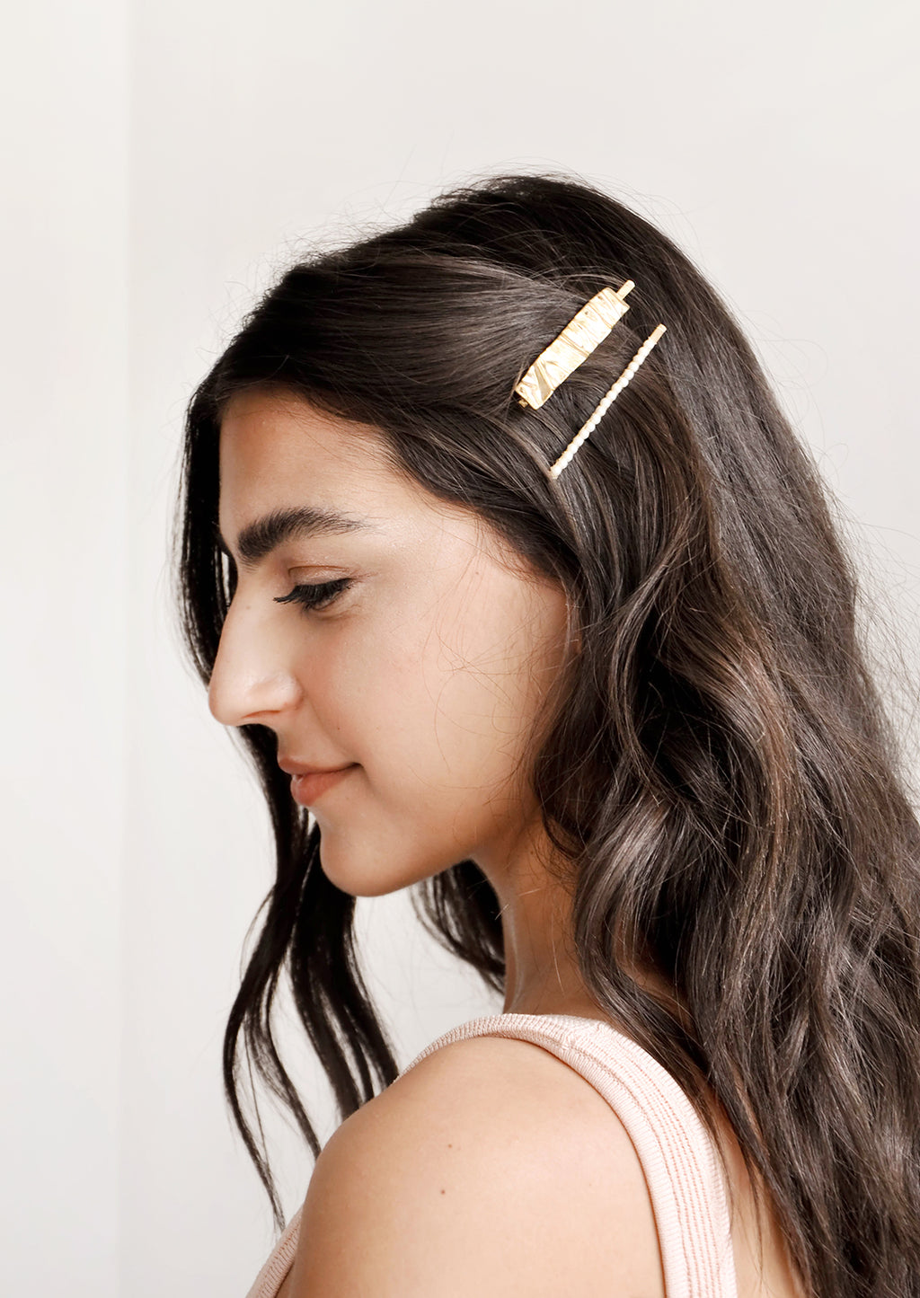 2: Two gold rectangular hair clips shown on model with brown hair