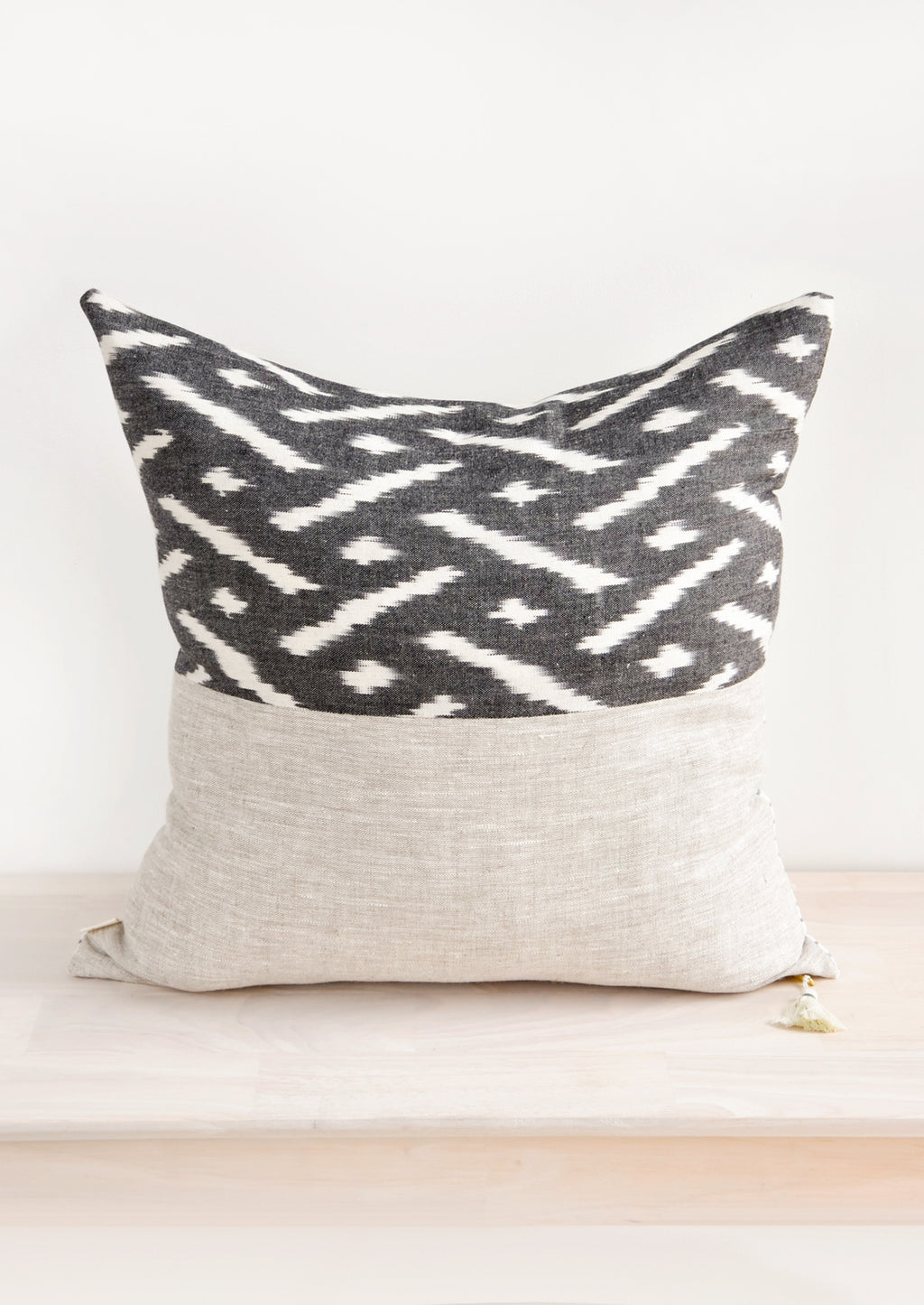 2: Square throw pillow in reversible design with contrasting black and white fabric on front and back