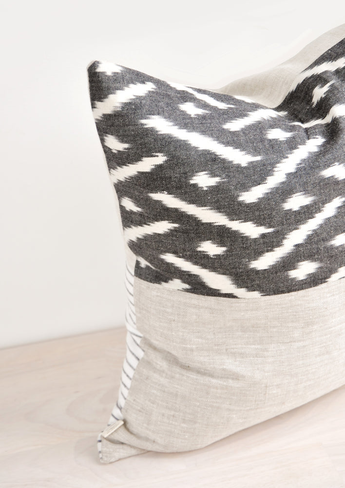 1: Square throw pillow in reversible design with contrasting black and white fabric on front and back