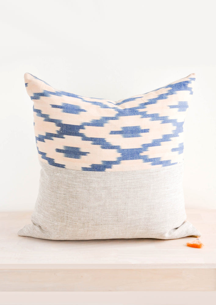 1: Square throw pillow with pink and blue printed top half and natural linen bottom