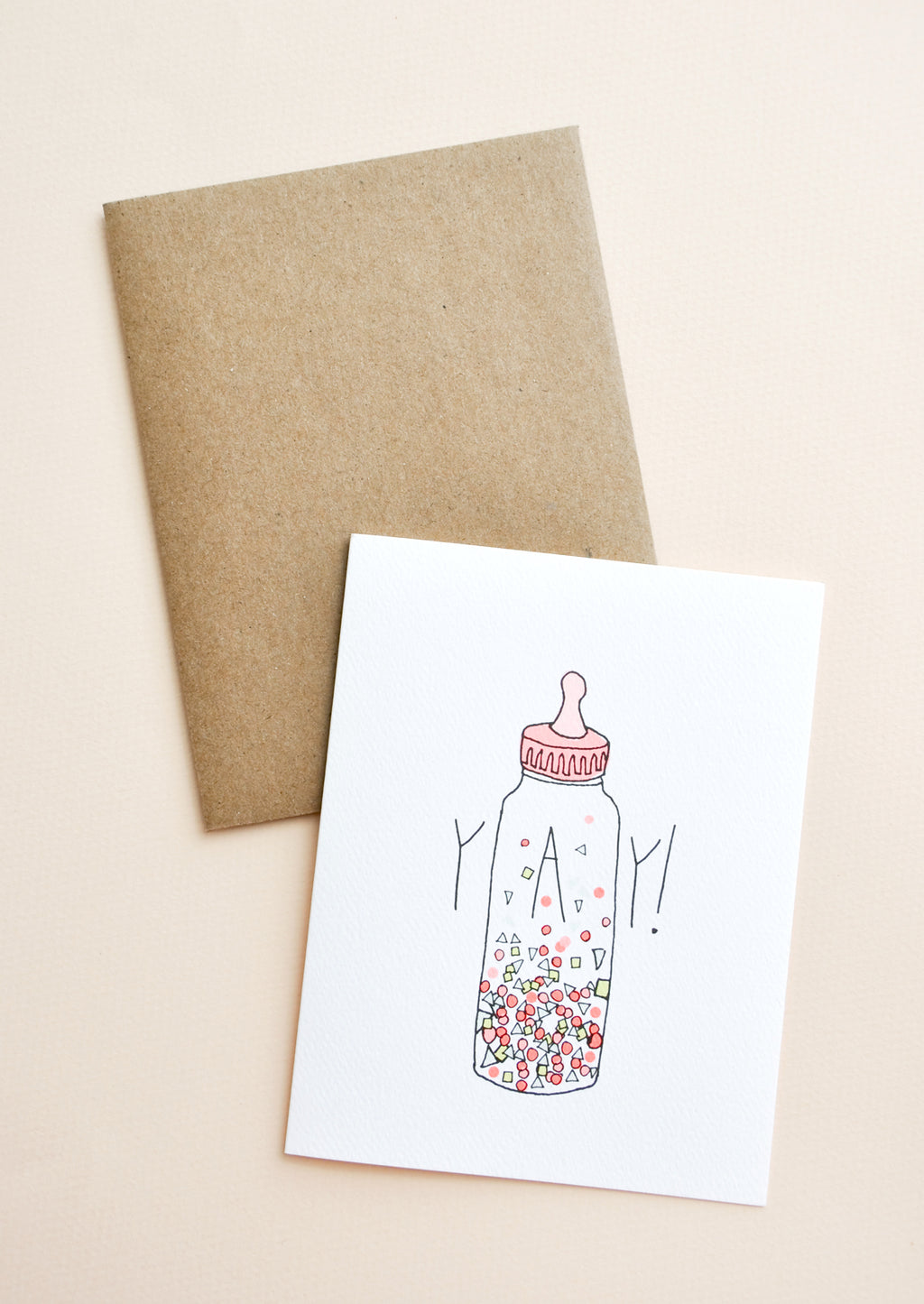 "1: Greeting card with baby bottle filled with confetti and ""YAY!"" text"