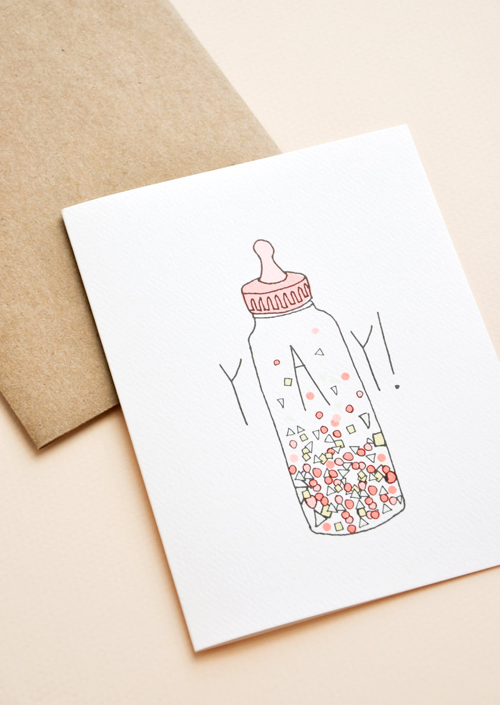 "2: Greeting card with baby bottle filled with confetti and ""YAY!"" text"