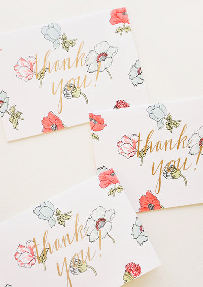 "Set of notecards with neon flowers and the text ""Thank you!"" in gold foil."