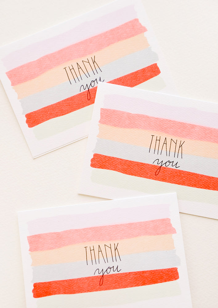 "1: Set of watercolor stripe Notecards with the text ""Thank you"""