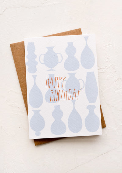 "A greeting card with outline of vases and ""Happy Birthday"" in copper letters."