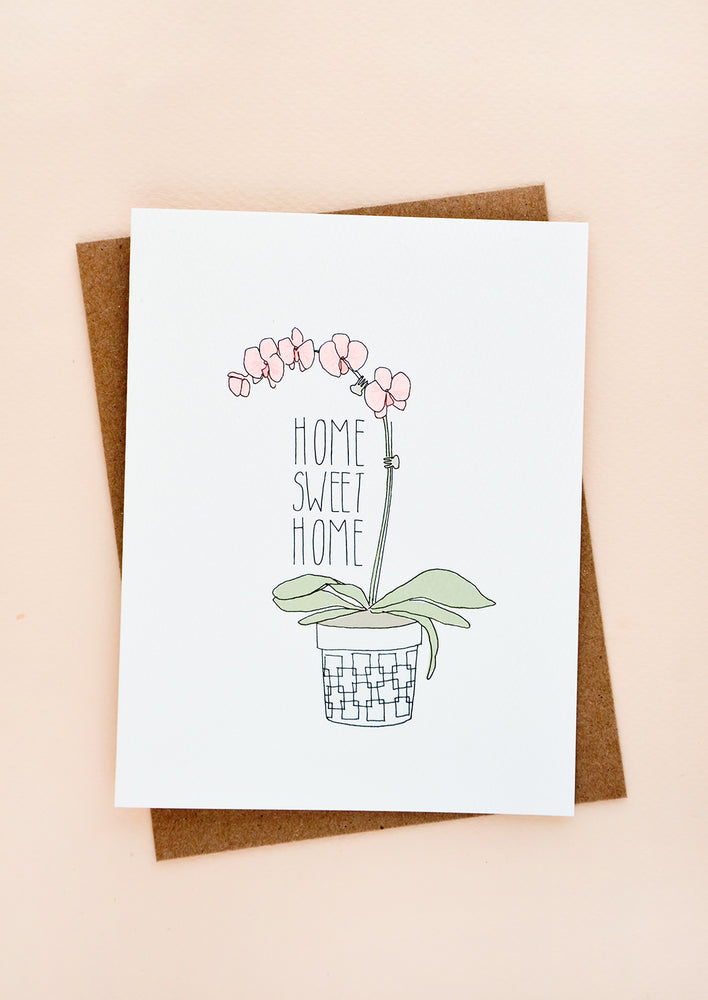 "1: Greeting card with image of potted orchid and text reading ""Home Sweet Home"""