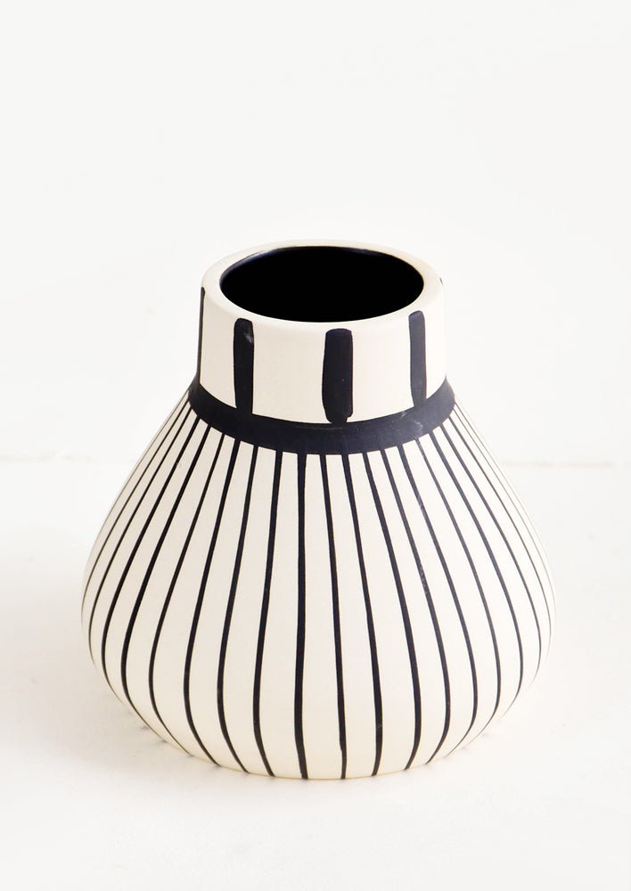 2: Ceramic vase in white with vertical black striping throughout