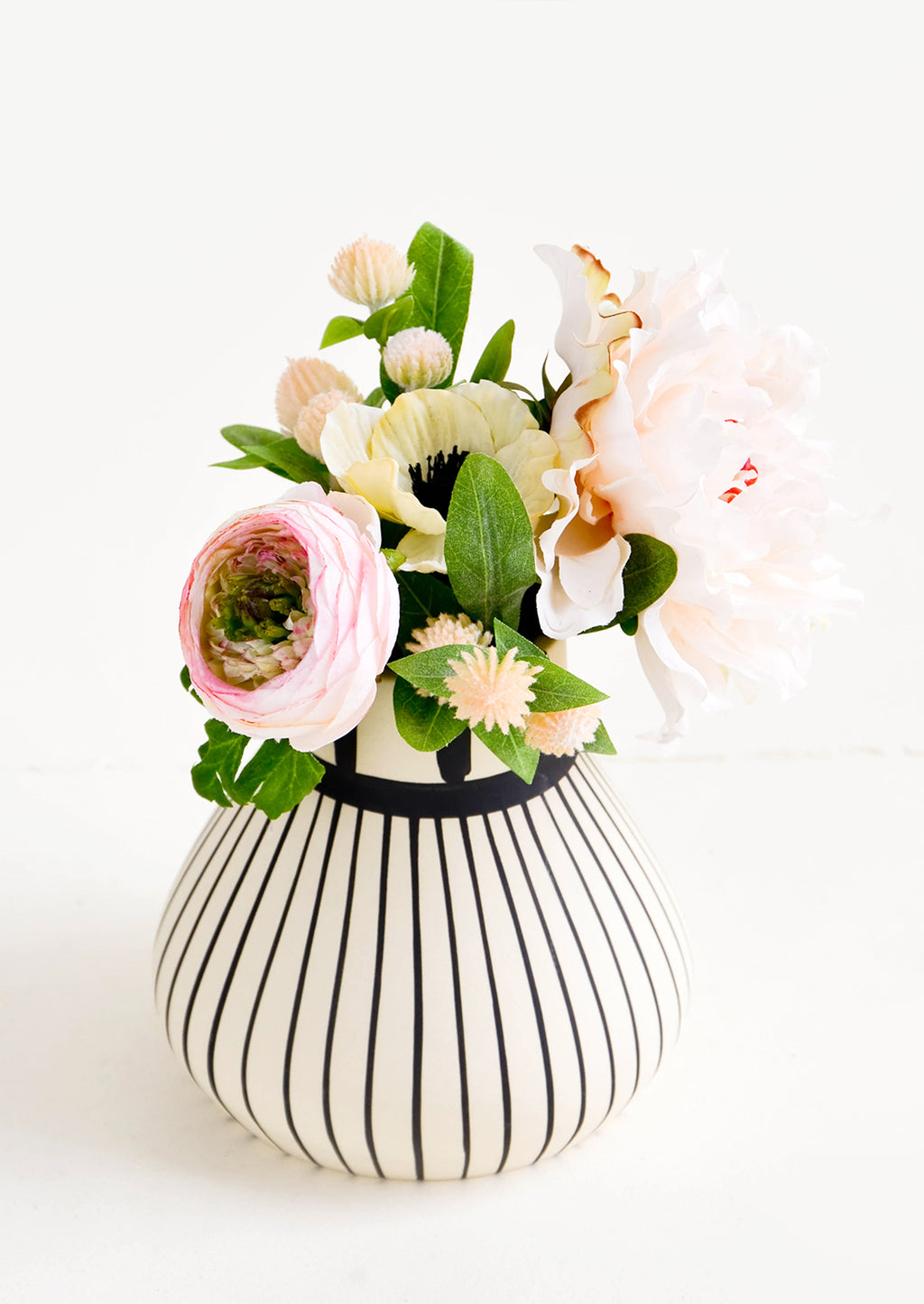 1: Black & white striped ceramic vase with a bouquet of flowers